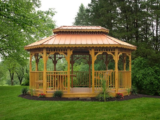 Wood Oblong Gazebo with picnic table, benches, and a swing